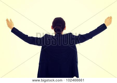 Businesswoman presenting space with arms wide open.