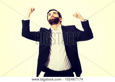Young successful businessman making fists.