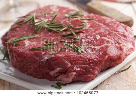 Cut of raw marble beef on a cutting board