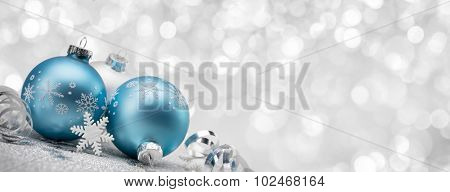 Blue Christmas balls with decoration on shiny background