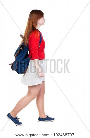 back view of walking  woman in dress with backpack.  girl in motion. backside view of person.  Rear view people collection. Isolated over white background. Young tourist in a white skirt goes to left