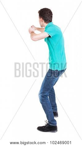 back view of skinny guy funny fights waving his arms and legs. Isolated over white background. Rear view people collection.  backside view of person. Funny guy put his fists in front of him.