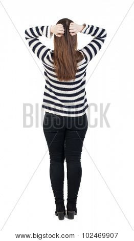 Back view of shocked woman in jeans. girl hid his eyes behind his hands.  Rear view people collection.  backside view of person.  Isolated over white background.