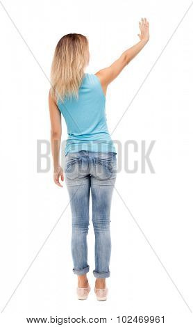 Back view of beautiful woman welcomes. Young teenager girl in jeans hand waving from. Rear view  people collection.  backside view of person.  Isolated over white background.