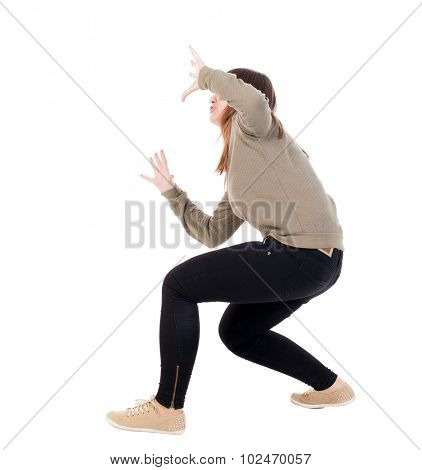 Side view. girl sat on his hands defensively on top of something.   Standing young girl in parka. Rear view people collection.  backside view of person.  Isolated over white background.