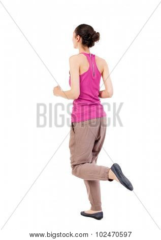 back view of running  woman. beautiful girl in motion. backside view of person.  Rear view people collection. Isolated over white background. African-American woman jogging