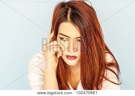 Serious Young Woman Pondering Over Something.