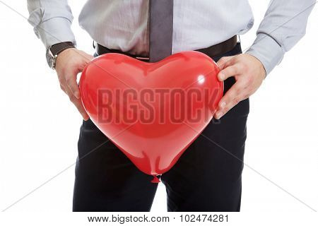 Young happy man with heart balloon.