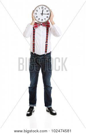 Funny man wearing suspenders hiding behind big clock.