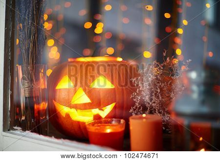 Halloween pumpkin with inside light and burning candles