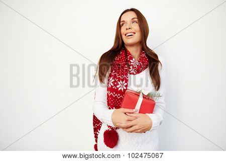 Happy young woman with red giftbox