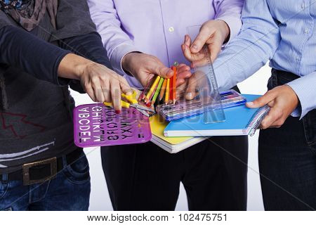 Group of hands holding education objects (selective focus)