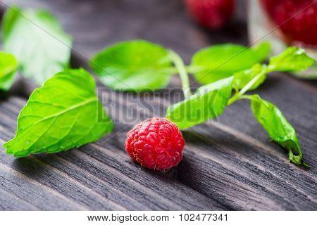 Fresh raspberry over dark wooden background