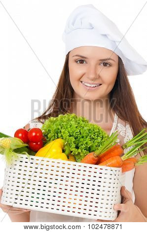 Woman cook in chef hat with fresh vegetables, isolated on white background.