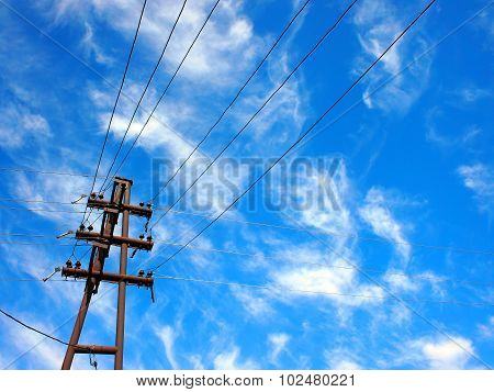 Upward View On Power Lines And Electric Pole
