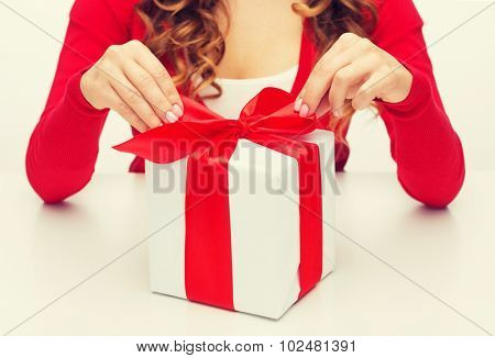 christmas, x-mas, happiness, winter and people concept - woman hands opening gift box