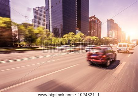 Car driving on road at sunset, motion blur