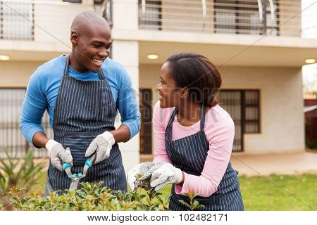 black couple gardening in front yard