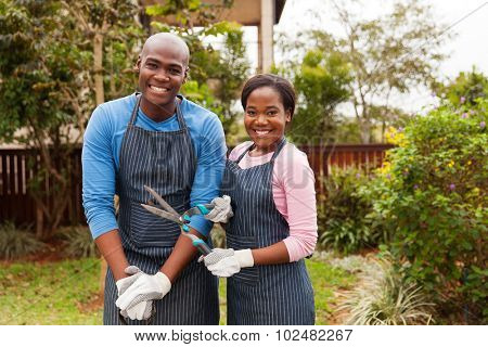 portrait of lovely african american couple standing in home garden