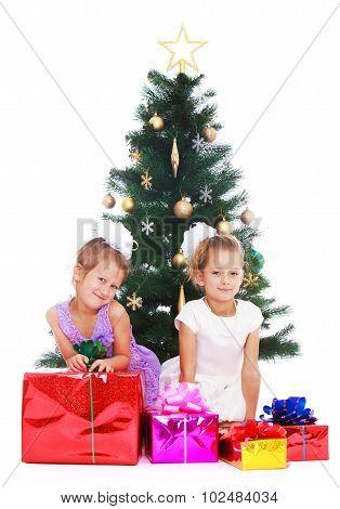 Sisters at Christmas tree