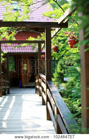 Beautiful wooden bridge with flowerpots