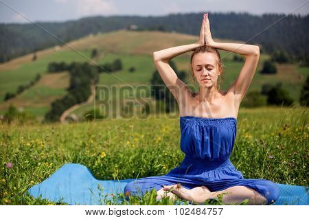 young girl in a meditation on the nature