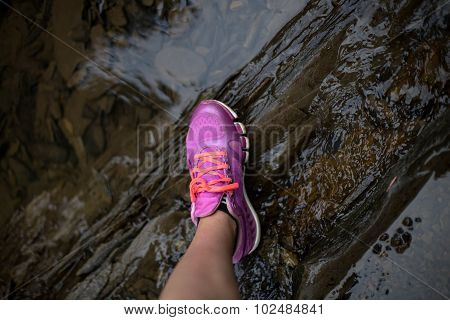 the leg of a girl who cross the river