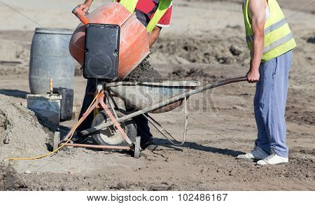 Workers With Concrete Mixer