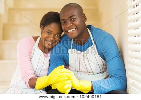 happy young african couple relaxing after housework