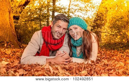 smiling leaves boyfriend with girlfriend on the ground