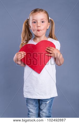 beloved little cute girl holding heart