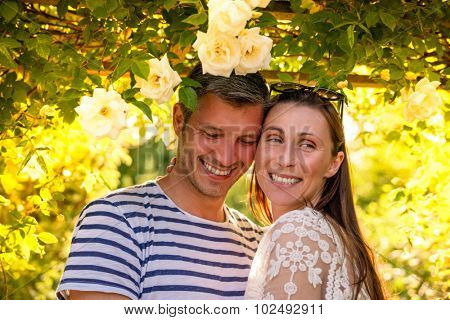 smiling embracing under flowers