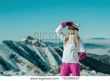 Female stay on the top of mountain with beautiful view