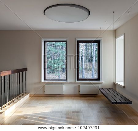 Interior Of Modern Empty Space With Suspended Bench And Windows