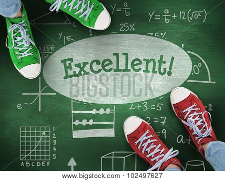 The word excellent! and casual shoes against green chalkboard
