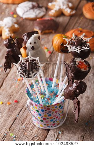 Delicious Cake Pop Halloween In A Bucket On The Table. Vertical