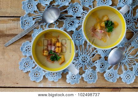 Mashed Potato Soup With Bacon On A Wooden Table