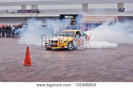 ZHYTOMYR, UKRAINE - SEPTEMBER 05 2015: Sports a car in a cloud of smoke