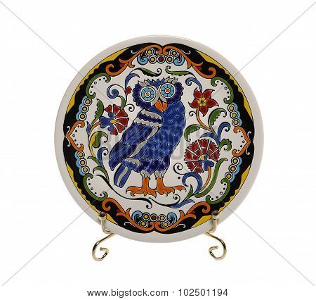 Decorative ceramic saucer with owl and ornament