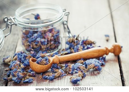 Healthy Forget Me Not Tea In Glass Jar And Wooden Spoon. Selective Focus.