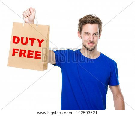 Young man hold with shopping bag and showing duty free