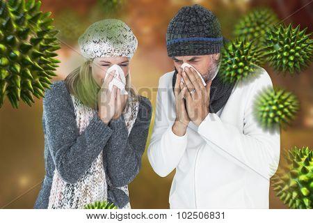 Couple sneezing in tissue against autumn scene