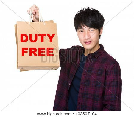 Asian Man hold with shopping bag and showing phrase of duty free