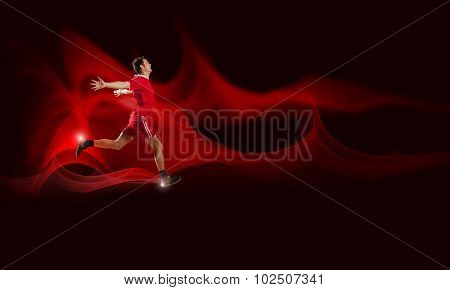Running man in red sport wear on red background