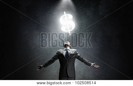 Businessman with hands spread apart and money sign above