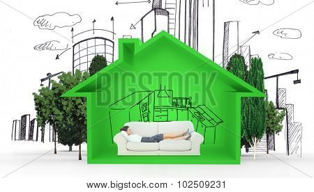 Smiling business woman lying down on the couch against house shape with kitchen sketch