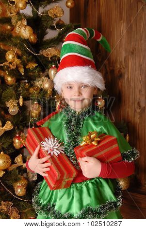Girl - the Christmas elf with a gift