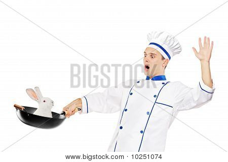 A Surprised Chef Holding A Wok With A Rabbit In It