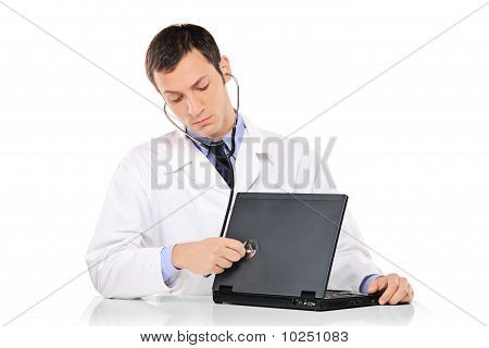 Pc Doctor Examining A Laptop Computer