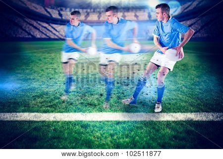 Rugby player doing a side pass against rugby pitch